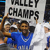 Champs: ISU senior Isiah Martin hoists a polacard declaring them the MVC champions.