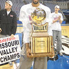 Tribune-Star/Rachel Keyes<br /> Yes we did: Indiana State's Isiah Martin hold up the Missouri Valley Conference trophy at rally welcoming the Sycamores home.