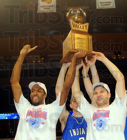 Ours: ISU seniors Isiah Martin, Jake Kelly(back) and Aaron Caarter hoist the teams MVC chamionship trophy