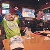 Tribune-Star/Rachel Keyes<br /> Shear joy: Indiana State Students Eric Dyar (left) and Tim Backfish watch the Sycamores in the MVC Championship game a Buffalo Wild Wings.