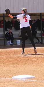Pitcher Cindy Boomhower warms up before the top of the inning.