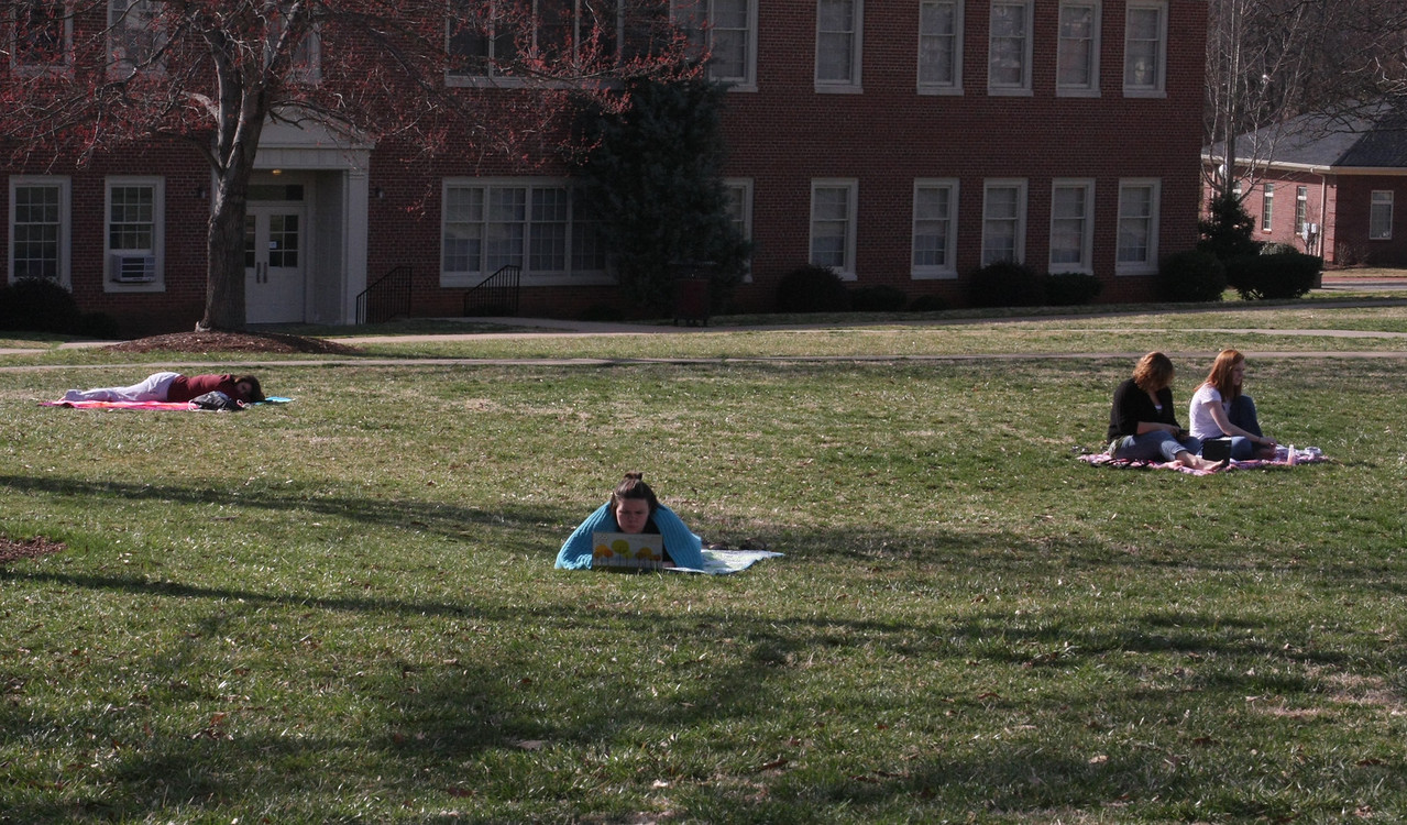 Students enjoy the warm Thursday afternoon.