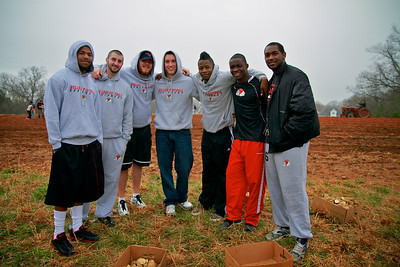 GWU Football team participates in a day of service Potato Project locally by helping plant and fertilize a field.