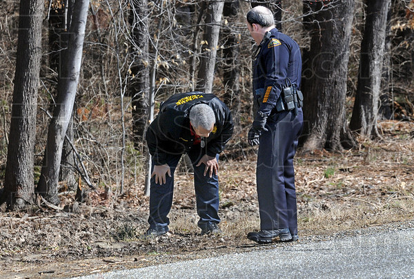 Evidence: Detective Lt. Ed Tompkins and uniform Chief Marc Eldred search the area along Poplar Street near Dobbs Park for evidence Friday afternoon.