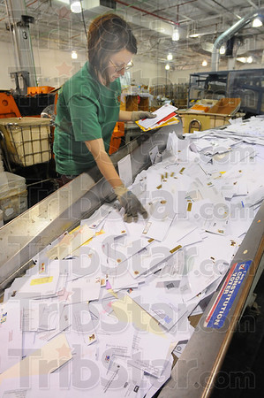 Tribune-Star/Jim Avelis<br /> Under study: Allison Pope feeds mail into the canceling machine at the United States Post Office mail handling center on Margaret avenue. A study is under way to determine a possible location change for some of the services at the facility.