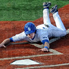 Score: Indiana State's #1, Tyler Wampler dives into home plate to score during game action against Western Illinois Friday afternoon at Bob Warn Field.