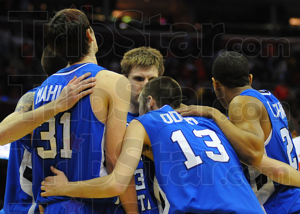 Together: The ISU team huddles just after R.J. MAhurin is called for his fifth foul.