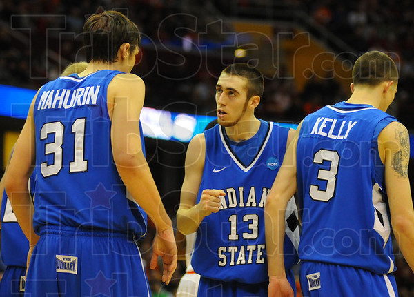 Stick together: Jake Odum talks with his teammates as Jake Kelly gets ready to shoot free throws.