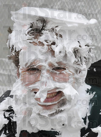 Tribune-Star/Rachel Keyes<br /> Whipped: Blumberg Hall RA Eric Liobis was a good sport at as students creamed him in the face with pies at a fundraiser for the Red Cross.