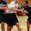 Tribune-Star/Rachel Keyes<br /> In the lane: Terre Haute South 2002 grad Melanie Boeglin drives the lane midst Terre Haute North defenders in the 1st Annual North vs. South Alumni Game.
