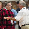 Tribune-Star/Rachel Keyes<br /> Familiar Competition: Terre Haute South's Pat Rady coach chat with Terre Haute North's Coach Jim Jones before the North vs. South alumni game Friday.