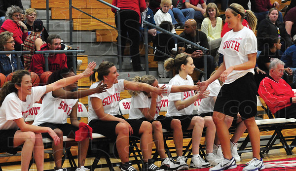 Tribune-Star/Rachel Keyes<br /> High five: Terre Haute South's Kristen Weddle Nasser is welcomed back to the bench by teammates in the 1st annual North vs. South Alumni Game Friday night.