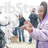 Tribune-Star/Rachel Keyes<br /> Good cause: Rose-Hulman Professor Sriram Mohan takes a pie in the face from Rose-Hulman faulty member daughter Hailey Wondem at a fundraiser for the Red Cross sponsored by the Rose-Hulman chapter of Phi Gama Delta.