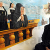 Preview: Bill Wolfe sits with his partially finished mural that will be displayed in the Vigo County Courthouse.