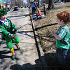 Tribune-Star/Rachel Keyes<br /> A giving leprechaun: Leprechaun and first grader at St. Patrick Elementary student Griffin Klingerman (left) hands a piece of candy to Abe Winniski at the St. Patrick's Parade.