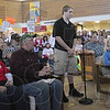 Tribune-Star/Rachel Keyes<br /> Student want answers: Terre Haute North High School sophomore Joseph Worthington stands up from among the crowd to ask the representatives a question regarding funding and charter schools.