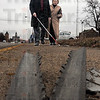 Danger: Danny Wayne and Beth Tevlin walk along south Third Street Thursday afternoon. Wayne shows Tevlin a broken piece of a street sign protruding from the sidewalk that poses an obstacle for him to navigate around.