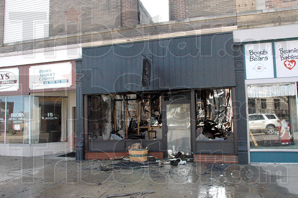 Destroyed: A business on the south side of the Sullivan square was destroyed by fire Friday night.