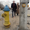 Obstacle: Danny Wayne navigates around a water hydrant on south Third Street. Wabash Valley Community Foundation executive director Beth Tevlin observes.