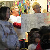 Tribune-Star/Rachel Keyes<br /> Lets Talk: Sarah Scott Teacher Becky Brown hold up a sign in protest of education legislation being considered by the Indiana General Assembly.