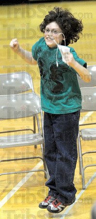 Yes: South Putnam Central Elementary school student Addison Hughes jumps for joy after winning the spelling bee Saturday afternoon.