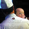What's Cookin': Chef Eddie Wilson holds his five-month-old son Charlie waiting for the start of the 100 Men Who Cook event at Hulman Center Saturday night.