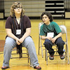 Down to us: Robin Cummins and Addison Hughes wait in anticipation of the spell-off between them during the finals of the spelling bee at Sarah Scott Middle School Saturday.