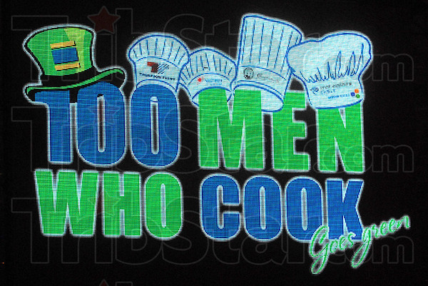 Sign: 100 Men Who Cook sign.