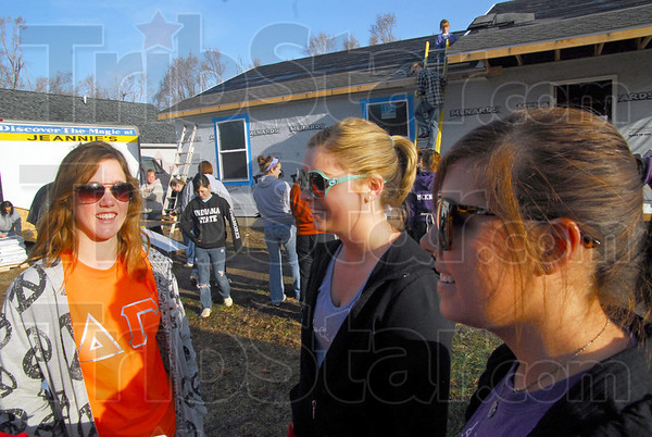 Sorority help: Indiana State University students Chelsea Stanley, Sarah Himpel and Kate Gillespie prepare for work on a Habitat House Saturday morning.