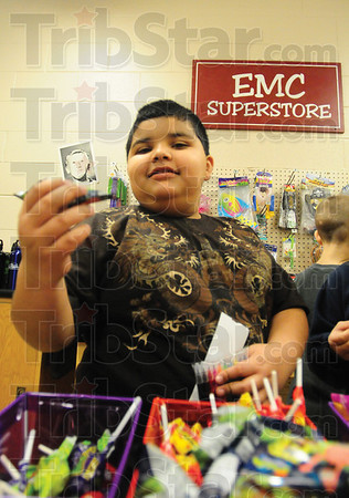 Tribune-Star/Rachel Keyes<br /> Ahh decisions: Second grader Rogelio Sanchez tries to decide how to spend is frank in the EMC Superstore at Franklin Elementary.