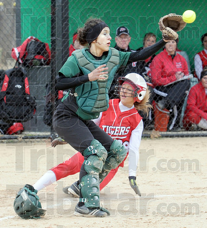 Score: Princeton's #28, Morgan Reneer scores as West Vigo catcher Lanie Shepard waits for the incoming throw during Saturday's game.