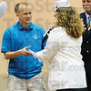 Tribune-Star/Rachel Keyes<br /> Special help: Jeff Mohler with the Special Olympics Indiana receives a check from the AM VETS out of Bloomington.