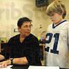 Tribune-Star/Rachel Keyes<br /> Keep trying: Vigo County Counselor Karla West (left) spends some time going over Franklin Elementary student Aaron Whitcotton's attendance record. He was late a few times and did not to earn a frank this week but is encouraged to try for the next week.