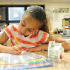 Making the grade: Franklin Elementary student Alexis Smith works on her Monday morning assignments.