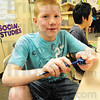 Tribune-Star/Rachel Keyes<br /> Ready to learn: Franklin Elementary fourth grader Gavin Nesbit sharpens is pencil before the Monday morning bell.