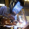 Welder: Rose-Hulman student John Daly welds on the front fork assembly of the under construction human powered vehicle Wednesday night on the Rose campus.