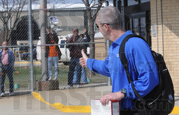 "Thumbs up: Indiana State University coach Greg Lansing gives a ""thumbs up"" to a group of well-wishers as he walks to the aircraft for the team's trip to Cleveland for the NCAA tournament."