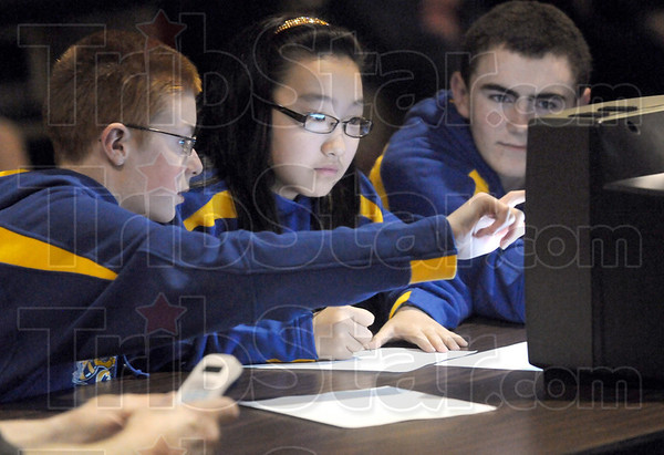 Geography: Honey Creek Geography Bowl contestants Jared Ankiam, Rita Cul and William Warner put their heads together to find the correct answer to one of the questions during the Wednesday evening competition.