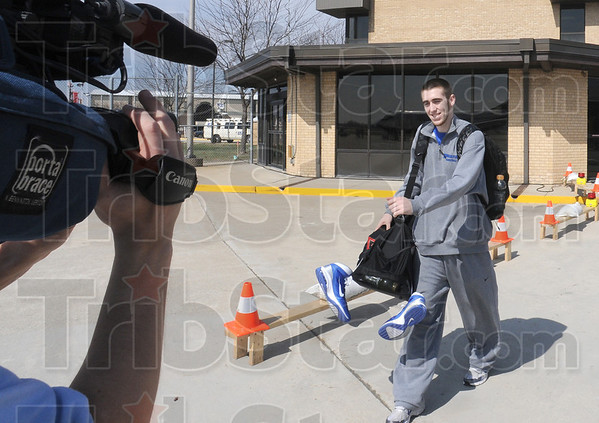 Jake: Indiana State University point guard Jake Odum gets lots of media attention as he walks to the waiting aircraft for his trip to Cleveland Wednesday afternoon. .