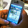 Website: Detail photo of the website on a cell phone.