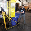 Recycle: Indiana State University recycling center employees Phil Sinclair and Jason Wenzel go about their daily business at the center Wednesday afternoon.