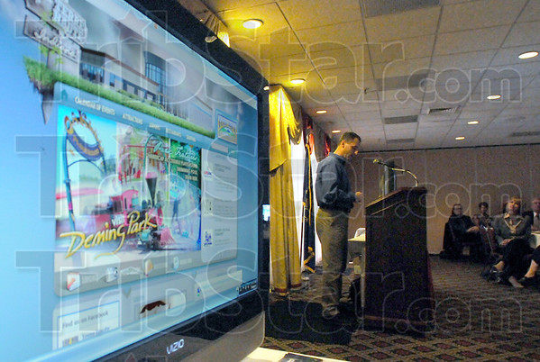 Website display: Zack Johnson of TABCOTECH explains the workings of the new website durng Wednesday's unveiling.