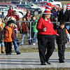 """Cat walk: An Ivy Tech representative walks children from Dixie Bee Elementary School to the Ivy Tech Community College - Wabash Valley campus for a viewing of Dr. seuss's """"Bartholomew and the Oobleck."""""""