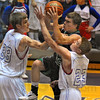 Tribune-Star/Jim Avelis<br /> And one: Jordan Houser drives the paint into the defense of Patriots Jansen Hight(33) and Evan Rice(23).