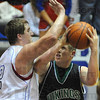 Tribune-Star/Jim Avelis<br /> Overmatched: Viking forward finds himself outsized by Owen Valley forward Dalton Vest in first half action of their sectional matchup Wednesday night.