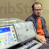Man and machine: Lewis, Indiana resident Clark Jerrell uses a dialysis machine like the one pictured for treatments in his rural home.