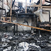 Tribune-Star/Rachel Keyes<br /> Charred remains: All that is left of the entryway the E.D. Powell Attorney At Law office building are the charred remains of two waiting room chairs and a table after a fire sent the office a blaze Friday night.
