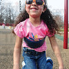 Tribune-Star/Rachel Keyes<br /> Spring Fever: Five-year-old Zoe Valdez enjoys the nice weather by playing hard at Deming Park.