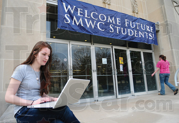 Tribune-Star/Rachel Keyes<br /> Study session: Creative writing major Emilie Blythe sits outside the library at St. Mary of the Wood College.