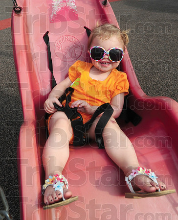 Tribune-Star/Rachel Keyes<br /> Relaxing: Peytyn Wardenburg sports her cool shades as she relaxes in a swing a Deming Park Monday.